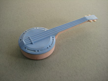 Banjo shaped baby rattle